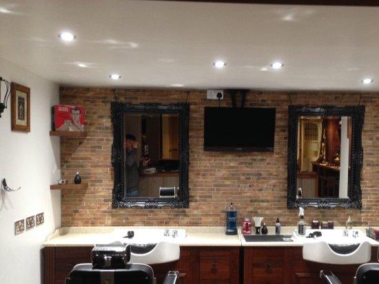 Walton-On-Thames, UK: Barbershop section of pub run By John Lala