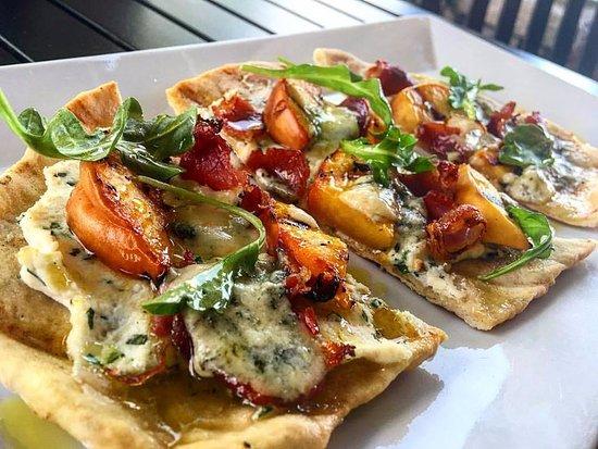 Solstice Kitchen: Grilled SC Peach & Pancetta Flatbread w/herb ricotta, artisan blue cheese, EVOO & baby arugula.
