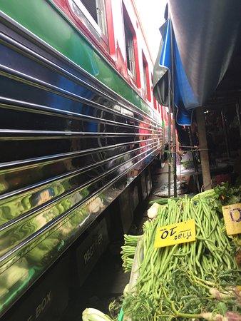 Samut Songkhram, Thailand: train passing by
