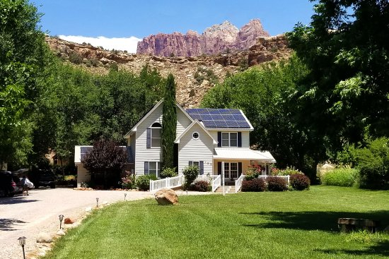 Rockville, UT: New solar panels, with Zion cliffs in the background.