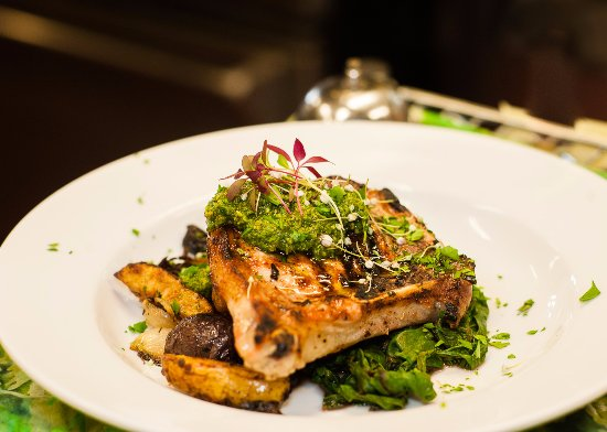 Philomath, OR: Grilled pork chop with roasted new potatoes, olives, rainbow chard and a basil walnut pesto