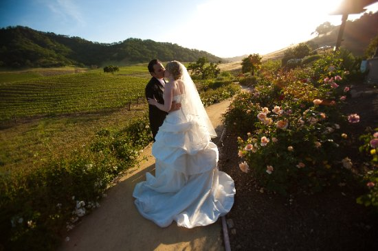 Clos LaChance Winery: Estate vineyard and happy married couple