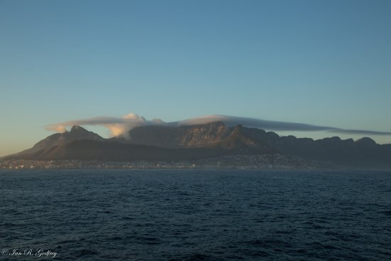 Cape Town nestles in the early morning light below Table Mountain viewed from the RMS St. Helena