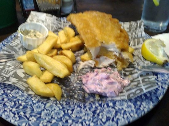 Fish chips and pink coleslaw all served on fake for Fish and chips newspaper