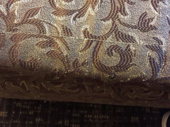 Eden Resort and Suites, BW Premier Collection: worn dated sofa