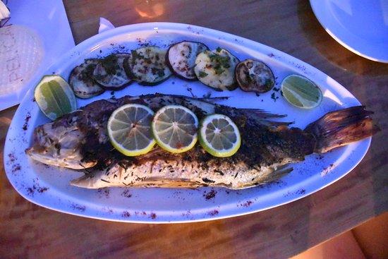 Tamanique, El Salvador: Roasted fish with romero