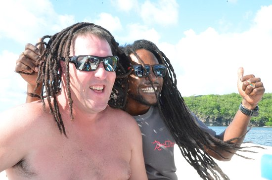 Gros Islet, Saint Lucia: If you are lucky enough, maybe you can try on Razz Benji's dreads too!