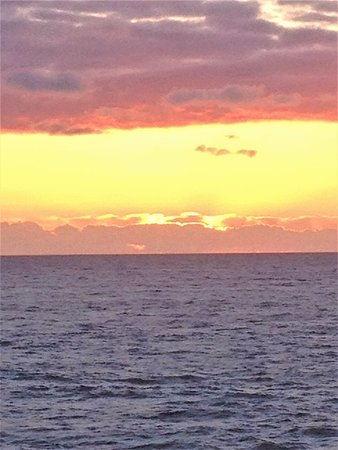 Depoe Bay, OR: Vibrant colors of sunset over the ocean at WorldMark