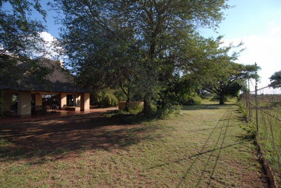 Satara Rest Camp: The house sits right on the fence line of the camp.