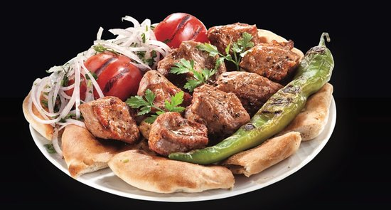 Nea Smirni, Greece: the sevilian,marinated pork skewered slowly grilled in order to be juicy.