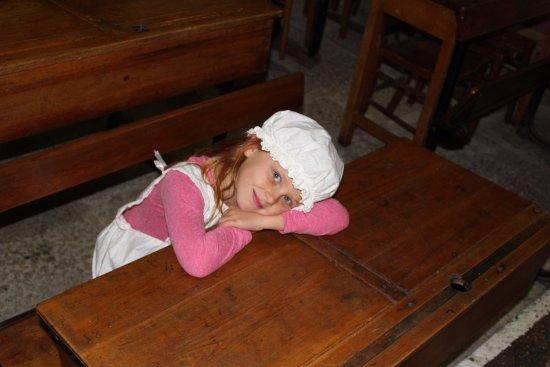 Helston, UK: A young visitor enjoying our Victorian Schoolroom