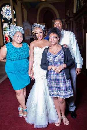 Augusta, GA: My daughter and took a photo with the bride and groom.