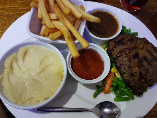 Bukhara: Well done Aberdeen Angus beef Steak with Chips