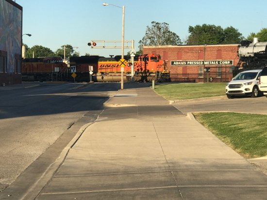 Galesburg, IL: A BNSF train going by on the rails behind the restaurant