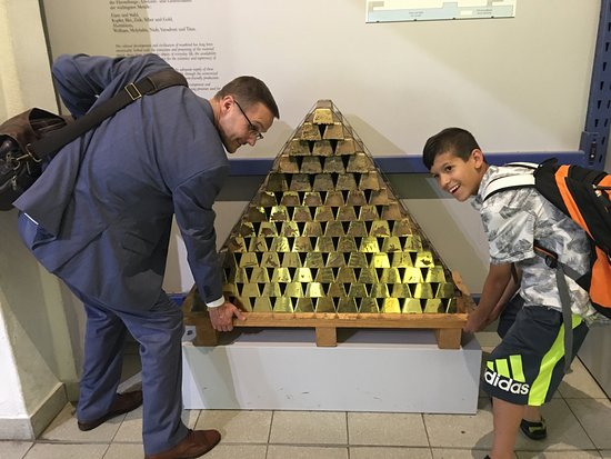 Deutsches Museum: My husband and son attempted to take this stack of gold as a mime to. Too bad it was too heavy!