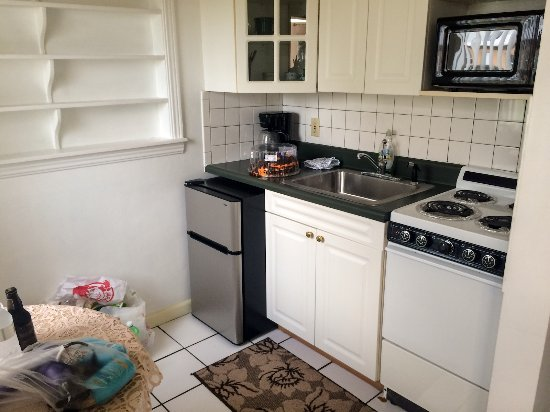 Indialantic, FL: Small kitchen with table for two. Small fridge; no dishwasher, but who needs more?