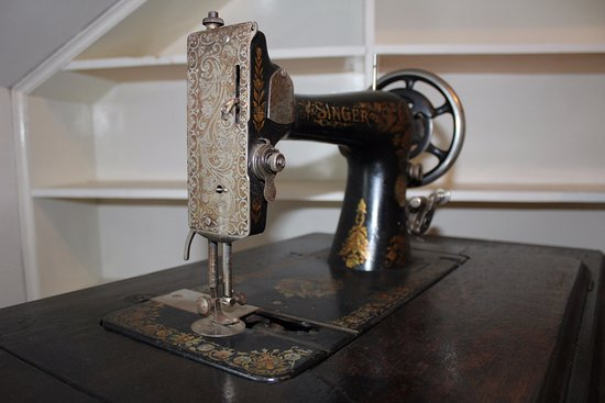 Miramichi, Canada: An old Singer sewing machine. Come learn about the evolution of fashion from the late 1870 to 19