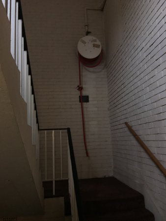 Epping, UK: One of the stairwells. The fire hose was missing in the other stairway