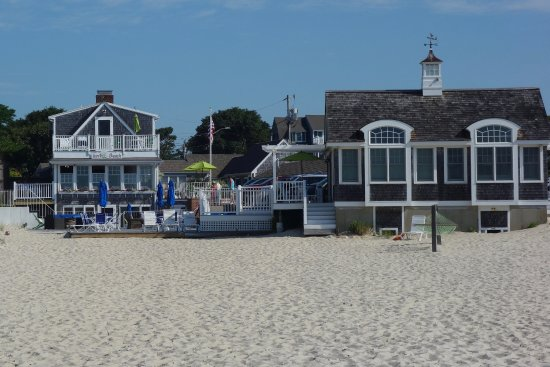 Inn On The Beach: Main building with breakfast room overlooking deck and beach on left. Beachfront rooms on right.