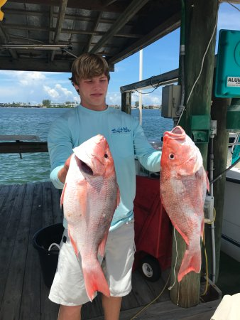 Bradenton Beach, FL: This guy killed it today with the red grouper, he needs another hand!!