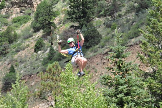 Idaho Springs, CO: Having a ball on my first zip line trip. Loved flying over the creek!
