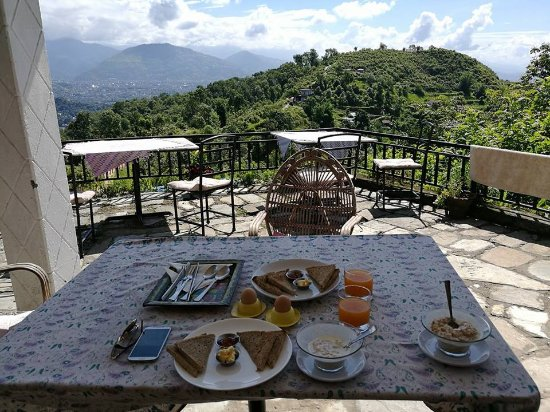 enjoing the breakfast picture of peace dragon lodge pokhara rh tripadvisor com