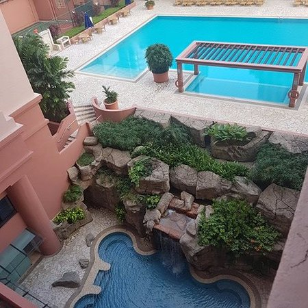 Great World Serviced Apartments: view from my balcony of pool and jacuzzi