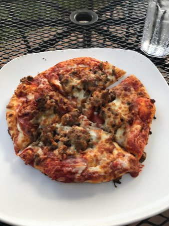 """Embers Restaurant: I got 8"""" pizza named 'Carnivore' with pepperoni, sausage, bacon, canadian bacon, beef. Delicious"""