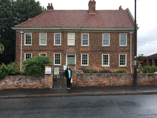 Yellow Moon Tours: My wife outside the rectory in Epworth, where John and Charles Wesley grew up.