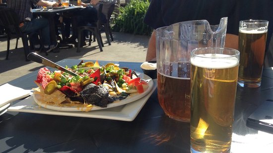 Taps On Queen Brewhouse and Grill: Friday special is nachos and a pitcher of beer