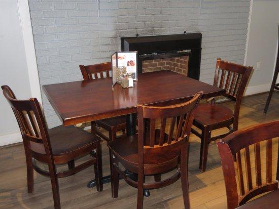 Boomerangs Original Ribs: Wood Tables, Unupholstered Chairs, Vinyl Plank Floor, Comfortable, But Noisy