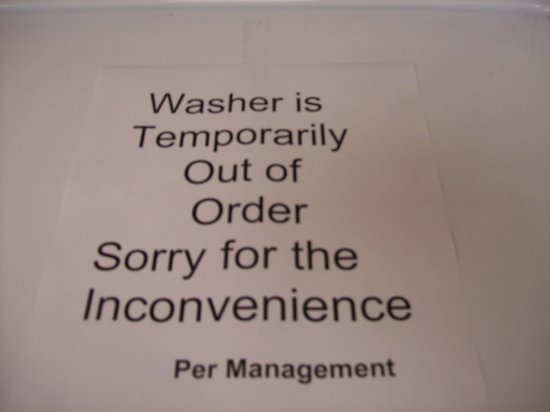 Holyoke, MA: Guest Laundry, the signage about the one Washer out of order.