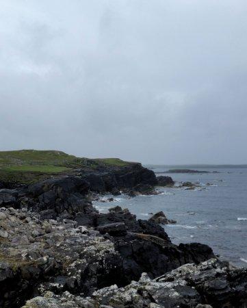 Stornoway, UK: Sea cliffs near to Arnol Village. Just a few minutes walk from the blackhouse.