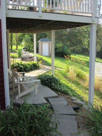 Plain & Fancy Bed & Breakfast: Plain & Fancy-Scarlett's Hideaway Patio overlooking Stouts Creek