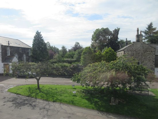 Embleton, UK: Side view of village green