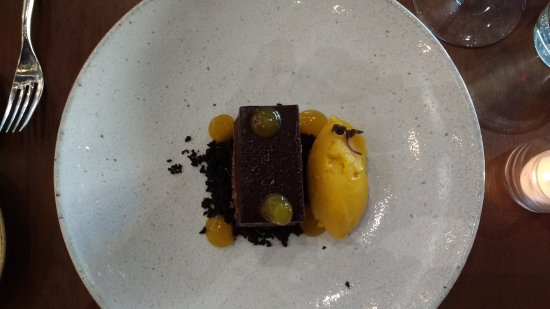 Gaithersburg, MD: delicious chocolate mango desert, the big plat renders a petite proportion