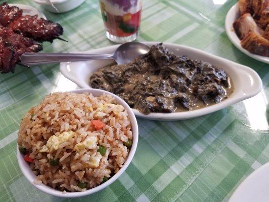 Westbury, NY: Simple bowl of fried rice and stewed taro leaves (Filipino version of collard greens)