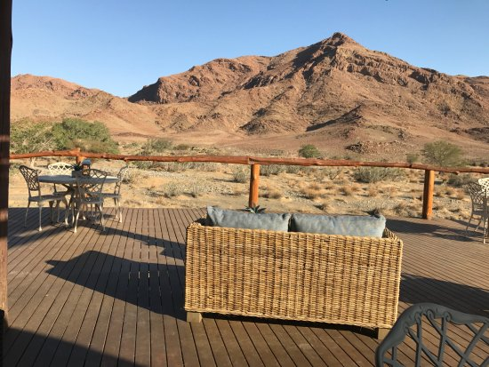 Sesriem, Namibia: View of lion head rock (look carefully at the rocky hill to the left) from the large deck