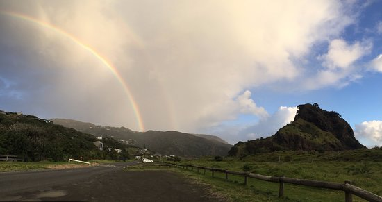 Piha, New Zealand: Lion's Rock and a Rainbow!