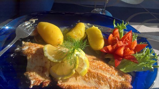 Luvia, Finland: White fish, new potatoes and tasty butter sause. Nice dish(