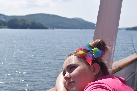 Bowness-on-Windermere, UK: A young pretty girl in a daydream with the beauty