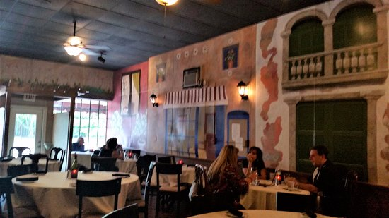 Couco Pazzo Italian Bistro: More open and lighter dining area with hand painted walls.