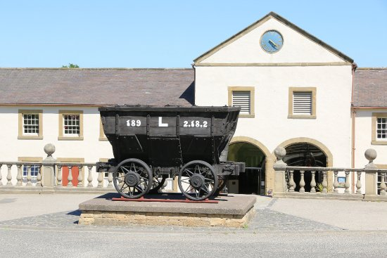 Beamish, UK: This is the main entrance, with an old coal tub parked outside.