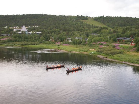 Two boats heading upstreams Karasjok river