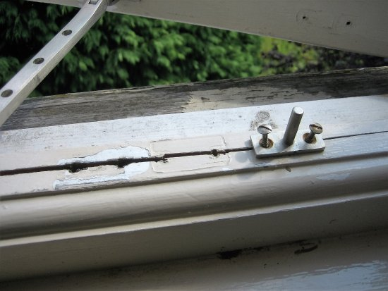 Escrick, UK: Bodged repairs to the window frame, seems typical of maintenance