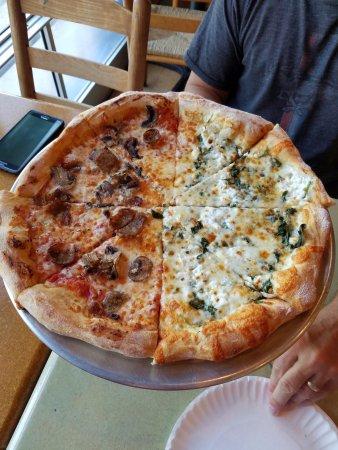 "Davidson, North Carolina: half sausage & mushroom & half White Pizza with spinach added (14"" pizza)"