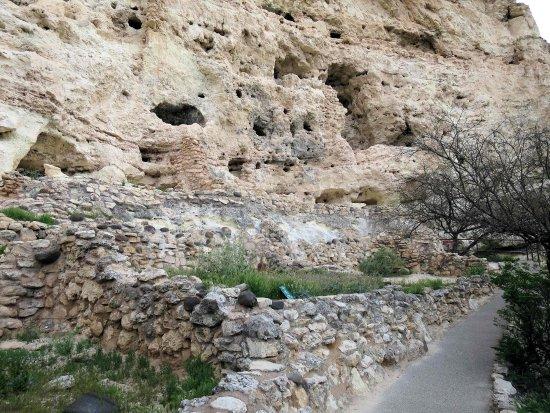 Camp Verde, AZ: Paved walkway along ruins at base of cliff