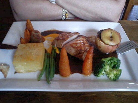 Burscough, UK: Roast pork delight, note baked whole apple (with black pudding). Veg perfect, not too 'al dente'
