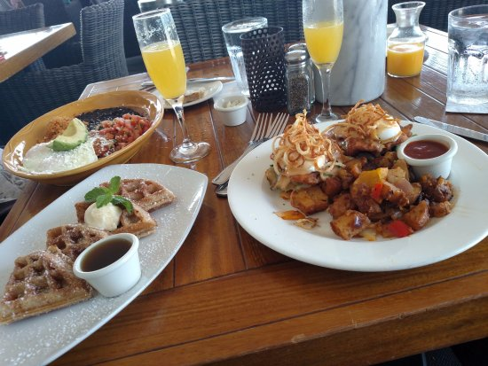 Cardiff-by-the-Sea, CA: From left; Lobster Chilaquiles, Churro Waffles, Chicken and Bisquits.