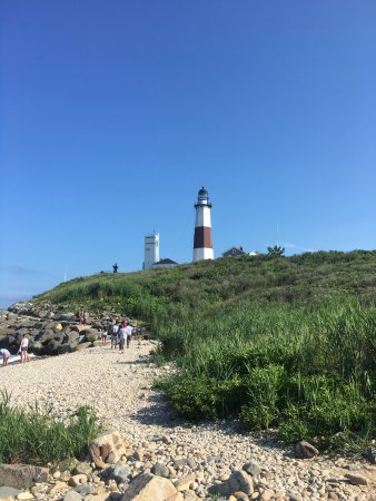 Montauk Point Lighthouse From Beach To The Rocks Below